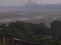 This is an image of the Taj Mahal as seen from Agra Fort through the miles of air pollution.