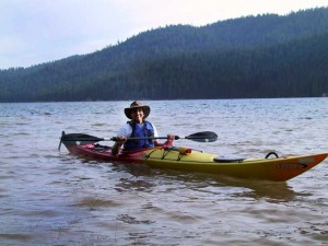 This is a photo of Anand in a kayak on Butt Lake, CA.