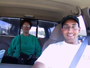 This is a photo of Anand at the wheel of our F250 taken from the dashboard and my mom sitting in the back seat of the crew cab.