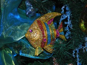 This is a photo of a fish Christmas ornament with glitter stripes.