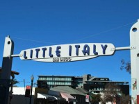 "This is a photo of India Street signage proclaiming ""Little Italy""."