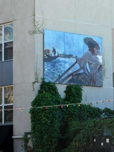This is a photo of a large Italian themed image painted on an office building in Little Italy.