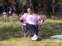 This is a photo of my mom on Butt Lake in a camping lounge chair.