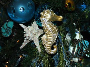 This is a photo of a gold sea horse Christmas ornament.