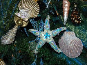 This is a photo of a starfish Chrsitmas ornament in aqua blue and pearl colors.