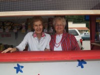 This is a photo of Marie Moore and Rose Butler of Garberville, CA in their fireworks sales booth.