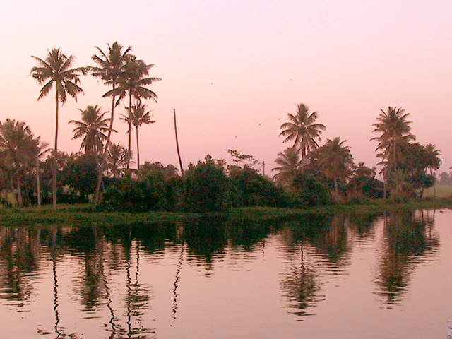 Scenic Kerala Waterways at sun down. Photography by Anne Marie Peterson-Kolatkar (c)2002.